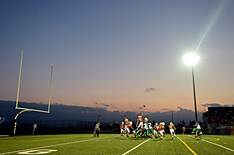 """St. Mary's kicks an extra point in the first half.  Mead lost to St. Mary's 21-20 during the varsity football game at Mead High School on Friday, Sept. 7, 2012.  For more photos visit  <a href=""""http://www.TimesCall.com"""">http://www.TimesCall.com</a>.<br /> (Greg Lindstrom/Times-Call)"""