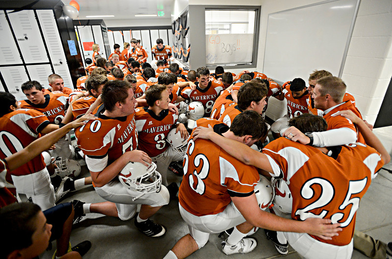 """Mead players join in a prayer before the game.  Mead lost to St. Mary's 21-20 during the varsity football game at Mead High School on Friday, Sept. 7, 2012.  For more photos visit  <a href=""""http://www.TimesCall.com"""">http://www.TimesCall.com</a>.<br /> (Greg Lindstrom/Times-Call)"""