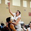"""Fort Morgan's Zach Garcia draws a charge from Mead's Conor Lamb, right, during the game at Mead High School on Wednesday, Feb. 27, 2013. Mead beat Fort Morgan 57-43 for its first-ever playoff victory. For more photos visit  <a href=""""http://www.BoCoPreps.com"""">http://www.BoCoPreps.com</a>.<br /> (Greg Lindstrom/Times-Call)"""