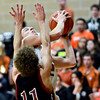 "Mead's Cody Beaver goes up for a shot over Fort Morgan's Tony Zwetzig (11) during the game at Mead High School on Wednesday, Feb. 27, 2013. Mead beat Fort Morgan 57-43 for its first-ever playoff victory. For more photos visit  <a href=""http://www.BoCoPreps.com"">http://www.BoCoPreps.com</a>.<br /> (Greg Lindstrom/Times-Call)"
