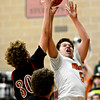 "Mead's Jacob Perez (5) goes up for a shot over Fort Morgan's Joey Schneider (30) during the game at Mead High School on Wednesday, Feb. 27, 2013. Mead beat Fort Morgan 57-43 for its first-ever playoff victory. For more photos visit  <a href=""http://www.BoCoPreps.com"">http://www.BoCoPreps.com</a>.<br /> (Greg Lindstrom/Times-Call)"