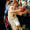 "Mead's Conor Lamb (11) drives past Fort Morgan's Tony Zwetzig during the game at Mead High School on Wednesday, Feb. 27, 2013. Mead beat Fort Morgan 57-43 for its first-ever playoff victory. For more photos visit  <a href=""http://www.BoCoPreps.com"">http://www.BoCoPreps.com</a>.<br /> (Greg Lindstrom/Times-Call)"