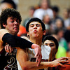 """Mead's Aaron Cheung is fouled by Fort Morgan's Jake Frick (24) during the game at Mead High School on Wednesday, Feb. 27, 2013. Mead beat Fort Morgan 57-43 for its first-ever playoff victory. For more photos visit  <a href=""""http://www.BoCoPreps.com"""">http://www.BoCoPreps.com</a>.<br /> (Greg Lindstrom/Times-Call)"""