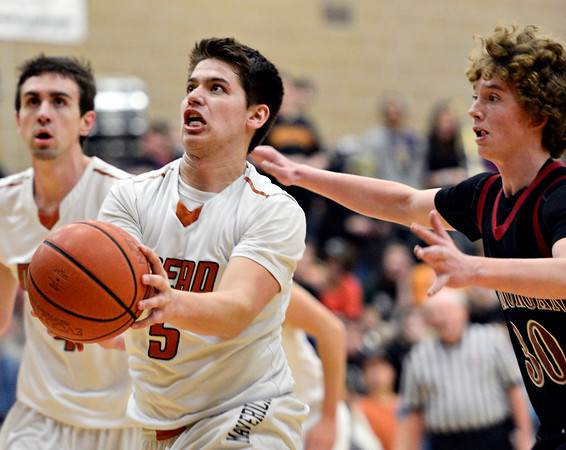 """Mead's Jacob Perez (5) looks to shoot over Fort Morgan's Joey Schneider (30) during the game at Mead High School on Wednesday, Feb. 27, 2013. Mead beat Fort Morgan 57-43 for its first-ever playoff victory. For more photos visit  <a href=""""http://www.BoCoPreps.com"""">http://www.BoCoPreps.com</a>.<br /> (Greg Lindstrom/Times-Call)"""