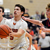 "Mead's Jacob Perez (5) looks to shoot over Fort Morgan's Joey Schneider (30) during the game at Mead High School on Wednesday, Feb. 27, 2013. Mead beat Fort Morgan 57-43 for its first-ever playoff victory. For more photos visit  <a href=""http://www.BoCoPreps.com"">http://www.BoCoPreps.com</a>.<br /> (Greg Lindstrom/Times-Call)"