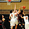 "Mead defenders, from left, Ryan Lozinski, Griffin Nelson and Cody Beaver contest a shot by Fort Morgan's Zach Garcia (20) during the game at Mead High School on Wednesday, Feb. 27, 2013. Mead beat Fort Morgan 57-43 for its first-ever playoff victory. For more photos visit  <a href=""http://www.BoCoPreps.com"">http://www.BoCoPreps.com</a>.<br /> (Greg Lindstrom/Times-Call)"