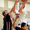 "Mead's Griffin Nelson goes up for a shot over Fort Morgan's Eric Kembel, left, and Leo Lopez (10) during the game at Mead High School on Wednesday, Feb. 27, 2013. Mead beat Fort Morgan 57-43 for its first-ever playoff victory. For more photos visit  <a href=""http://www.BoCoPreps.com"">http://www.BoCoPreps.com</a>.<br /> (Greg Lindstrom/Times-Call)"