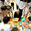 """Mead head coach Darin Reese draws up a play during the game at Mead High School on Wednesday, Feb. 27, 2013. Mead beat Fort Morgan 57-43 for its first-ever playoff victory. For more photos visit  <a href=""""http://www.BoCoPreps.com"""">http://www.BoCoPreps.com</a>.<br /> (Greg Lindstrom/Times-Call)"""