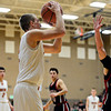 """Mead's Cody Beaver shoots over Fort Morgan's Wes Anderson (31)during the game at Mead High School on Wednesday, Feb. 27, 2013. Mead beat Fort Morgan 57-43 for its first-ever playoff victory. For more photos visit  <a href=""""http://www.BoCoPreps.com"""">http://www.BoCoPreps.com</a>.<br /> (Greg Lindstrom/Times-Call)"""