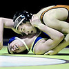"Frederick's Jordan DeFalco, left, struggles against Mead's Kyle McNellis during the match at Frederick High School on Thursday, Jan. 10, 2013. For more photos visit  <a href=""http://www.BoCoPreps.com"">http://www.BoCoPreps.com</a>.<br /> (Greg Lindstrom/Times-Call)"