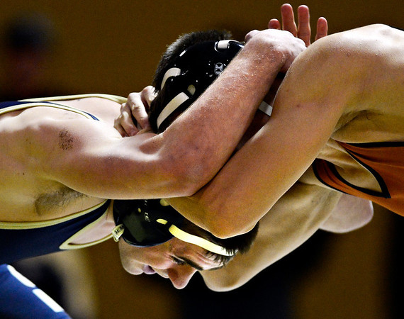 """Frederick's Jordan DeFalco, left, competes against Mead's Kyle McNellis during the match at Frederick High School on Thursday, Jan. 10, 2013. For more photos visit  <a href=""""http://www.BoCoPreps.com"""">http://www.BoCoPreps.com</a>.<br /> (Greg Lindstrom/Times-Call)"""