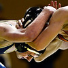 "Frederick's Jordan DeFalco, left, competes against Mead's Kyle McNellis during the match at Frederick High School on Thursday, Jan. 10, 2013. For more photos visit  <a href=""http://www.BoCoPreps.com"">http://www.BoCoPreps.com</a>.<br /> (Greg Lindstrom/Times-Call)"