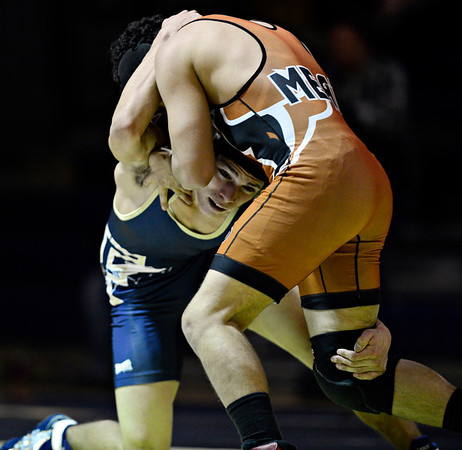 "Frederick's Dylan Shoop competes against Mead's Justice Lovato during the match at Frederick High School on Thursday, Jan. 10, 2013. For more photos visit  <a href=""http://www.BoCoPreps.com"">http://www.BoCoPreps.com</a>.<br /> (Greg Lindstrom/Times-Call)"