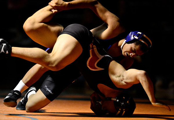 "Longmont's Fernando Ramos-Vega, top, and Mead's Gabe Alvarado compete during the dual meet at Mead High School on Wednesday, Feb. 6, 2013. For more photos visit  <a href=""http://www.BoCoPreps.com"">http://www.BoCoPreps.com</a>.<br /> (Greg Lindstrom/Times-Call)"