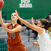 "Mead's Marina Hanlon (14) shoots over Niwot's Abbie Montgomery (0) during the game at Niwot High School on Tuesday, Dec. 11, 2012. Mead beat Niwot 52-19. For more photos visit  <a href=""http://www.BoCoPreps.com"">http://www.BoCoPreps.com</a>.<br /> (Greg Lindstrom/Times-Call)"