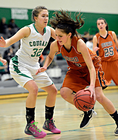 "Mead's Mikayla Martinez (5) tries to drive past Niwot's Anna Dunnell (32) during the game at Niwot High School on Tuesday, Dec. 11, 2012. Mead beat Niwot 52-19. For more photos visit  <a href=""http://www.BoCoPreps.com"">http://www.BoCoPreps.com</a>.<br /> (Greg Lindstrom/Times-Call)"