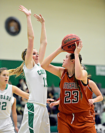 """Mead's Kari Lozinski (23) looks to shoot over Niwot's Hannah Sarosi (13) during the game at Niwot High School on Tuesday, Dec. 11, 2012. Mead beat Niwot 52-19. For more photos visit  <a href=""""http://www.BoCoPreps.com"""">http://www.BoCoPreps.com</a>.<br /> (Greg Lindstrom/Times-Call)"""