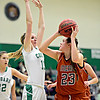 "Mead's Kari Lozinski (23) looks to shoot over Niwot's Hannah Sarosi (13) during the game at Niwot High School on Tuesday, Dec. 11, 2012. Mead beat Niwot 52-19. For more photos visit  <a href=""http://www.BoCoPreps.com"">http://www.BoCoPreps.com</a>.<br /> (Greg Lindstrom/Times-Call)"