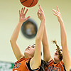 "Mead's Kasey McKrola (25) and Kari Lozinski (23) reach for a rebound during the game at Niwot High School on Tuesday, Dec. 11, 2012. Mead beat Niwot 52-19. For more photos visit  <a href=""http://www.BoCoPreps.com"">http://www.BoCoPreps.com</a>.<br /> (Greg Lindstrom/Times-Call)"