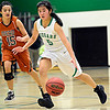 "Niwot's Cindy Yie (5) drives past Mead's Fei Daly (15) during the game at Niwot High School on Tuesday, Dec. 11, 2012. Mead beat Niwot 52-19. For more photos visit  <a href=""http://www.BoCoPreps.com"">http://www.BoCoPreps.com</a>.<br /> (Greg Lindstrom/Times-Call)"
