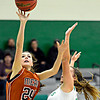"Mead's Rylee Ward (24) shoots around Niwot's Abbie Montgomery during the game at Niwot High School on Tuesday, Dec. 11, 2012. Mead beat Niwot 52-19. For more photos visit  <a href=""http://www.BoCoPreps.com"">http://www.BoCoPreps.com</a>.<br /> (Greg Lindstrom/Times-Call)"