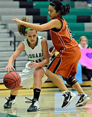 """Mead's Fei Daly, right, pressures Niwot's Jaelyn Larson during the game at Niwot High School on Tuesday, Dec. 11, 2012. Mead beat Niwot 52-19. For more photos visit  <a href=""""http://www.BoCoPreps.com"""">http://www.BoCoPreps.com</a>.<br /> (Greg Lindstrom/Times-Call)"""