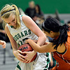 "Niwot's Hannah Sarosi, left, competes for a ball with Mead's Fei Daly during the game at Niwot High School on Tuesday, Dec. 11, 2012. Mead beat Niwot 52-19. For more photos visit  <a href=""http://www.BoCoPreps.com"">http://www.BoCoPreps.com</a>.<br /> (Greg Lindstrom/Times-Call)"