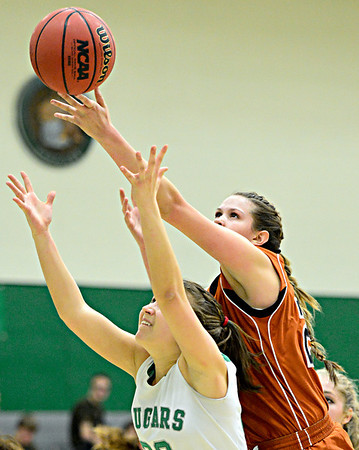 "Mead's Kari Lozinski, right, tries to grab a rebound over Niwot's Anna Dunnell (32) during the game at Niwot High School on Tuesday, Dec. 11, 2012. Mead beat Niwot 52-19. For more photos visit  <a href=""http://www.BoCoPreps.com"">http://www.BoCoPreps.com</a>.<br /> (Greg Lindstrom/Times-Call)"