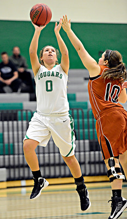 "Niwot's Abbie Montgomery (0) shoots over Mead's Samantha Kalivas (10) during the game at Niwot High School on Tuesday, Dec. 11, 2012. Mead beat Niwot 52-19. For more photos visit  <a href=""http://www.BoCoPreps.com"">http://www.BoCoPreps.com</a>.<br /> (Greg Lindstrom/Times-Call)"