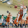 "Mead's Kasey McKrola (25) grabs a rebound over Niwot's Juliet Pilewskie, right, during the game at Niwot High School on Tuesday, Dec. 11, 2012. Mead beat Niwot 52-19. For more photos visit  <a href=""http://www.BoCoPreps.com"">http://www.BoCoPreps.com</a>.<br /> (Greg Lindstrom/Times-Call)"