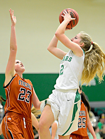 "Niwot's Callie Hensen (2) goes up for a shot over Mead's Kari Lozinski (23) during the game at Niwot High School on Tuesday, Dec. 11, 2012. Mead beat Niwot 52-19. For more photos visit  <a href=""http://www.BoCoPreps.com"">http://www.BoCoPreps.com</a>.<br /> (Greg Lindstrom/Times-Call)"