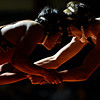 """Mead's Marco Clark, left, competes against Roosevelt's Tanner Bonds during the wrestling meet at Mead High School on Wednesday, Jan. 16, 2013. For more photos visit  <a href=""""http://www.BoCoPreps.com"""">http://www.BoCoPreps.com</a>.<br /> (Greg Lindstrom/Times-Call)"""