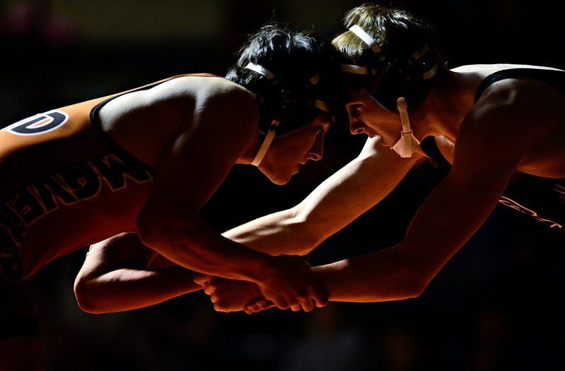 "Mead's Marco Clark, left, competes against Roosevelt's Tanner Bonds during the wrestling meet at Mead High School on Wednesday, Jan. 16, 2013. For more photos visit  <a href=""http://www.BoCoPreps.com"">http://www.BoCoPreps.com</a>.<br /> (Greg Lindstrom/Times-Call)"