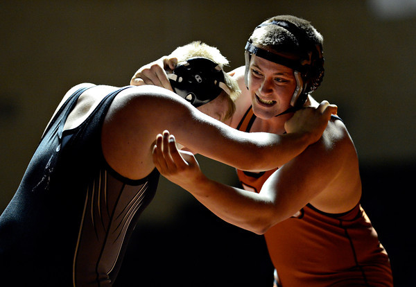 "Mead's Gabe Robinson, right, competes against Roosevelt's Andrew Dimmit during the wrestling meet at Mead High School on Wednesday, Jan. 16, 2013. For more photos visit  <a href=""http://www.BoCoPreps.com"">http://www.BoCoPreps.com</a>.<br /> (Greg Lindstrom/Times-Call)"