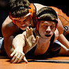 """Mead's Kyle Couch, left, competes against Roosevel'ts Quinton Phatt during the wrestling meet at Mead High School on Wednesday, Jan. 16, 2013. For more photos visit  <a href=""""http://www.BoCoPreps.com"""">http://www.BoCoPreps.com</a>.<br /> (Greg Lindstrom/Times-Call)"""