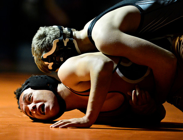 "Mead's Justice Lovato struggles against Roosevelt's Keagan Davis during the wrestling meet at Mead High School on Wednesday, Jan. 16, 2013. For more photos visit  <a href=""http://www.BoCoPreps.com"">http://www.BoCoPreps.com</a>.<br /> (Greg Lindstrom/Times-Call)"