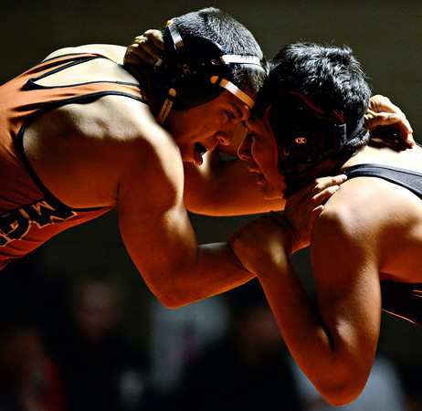 "Mead's Gabe Alvarado, left, competes against Roosevelt's Ray Garcia during the wrestling meet at Mead High School on Wednesday, Jan. 16, 2013. For more photos visit  <a href=""http://www.BoCoPreps.com"">http://www.BoCoPreps.com</a>.<br /> (Greg Lindstrom/Times-Call)"