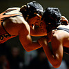 """Mead's Gabe Alvarado, left, competes against Roosevelt's Ray Garcia during the wrestling meet at Mead High School on Wednesday, Jan. 16, 2013. For more photos visit  <a href=""""http://www.BoCoPreps.com"""">http://www.BoCoPreps.com</a>.<br /> (Greg Lindstrom/Times-Call)"""