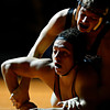 """Mead's Justice Lovato, bottom, struggles against Roosevelt's Keagan Davis during the wrestling meet at Mead High School on Wednesday, Jan. 16, 2013. For more photos visit  <a href=""""http://www.BoCoPreps.com"""">http://www.BoCoPreps.com</a>.<br /> (Greg Lindstrom/Times-Call)"""