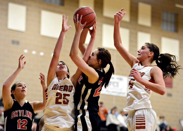 "From left, Allison Curtis, Kasey McKrola, Alyssa Steed and Mikayla Martinez compete for a rebound during the game at Mead High School on Friday, Jan. 4, 2013. Mead beat Skyline 52-40. For more photos visit  <a href=""http://www.BoCoPreps.com"">http://www.BoCoPreps.com</a>. <br /> (Greg Lindstrom/Times-Call)"