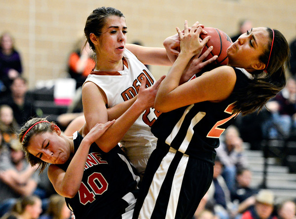 "Skyline's Carissa Curtis (40) and Naomi Barron (25) compete with Mead's Kasey McKrola for a loose ball during the game at Mead High School on Friday, Jan. 4, 2013. For more photos visit  <a href=""http://www.BoCoPreps.com"">http://www.BoCoPreps.com</a>. <br /> (Greg Lindstrom/Times-Call)"