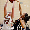 """Skyline's Naomi Barron blocks a shot by Mead's Kari Lozinski during the game at Mead High School on Friday, Jan. 4, 2013. Mead beat Skyline 52-40. For more photos visit  <a href=""""http://www.BoCoPreps.com"""">http://www.BoCoPreps.com</a>. <br /> (Greg Lindstrom/Times-Call)"""
