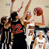 "Mead's Kasey McKrola (25) looks to shoot over Skyline's Alyssa Steed during the game at Mead High School on Friday, Jan. 4, 2013. Mead beat Skyline 52-40. For more photos visit  <a href=""http://www.BoCoPreps.com"">http://www.BoCoPreps.com</a>. <br /> (Greg Lindstrom/Times-Call)"