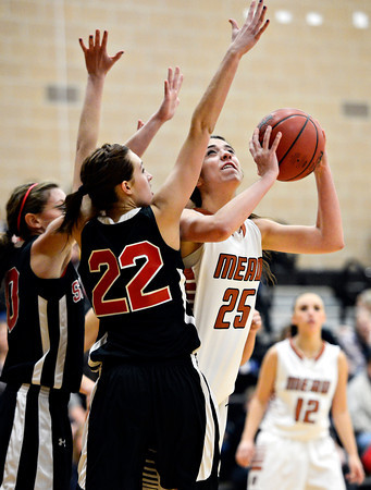 """Mead's Kasey McKrola (25) looks to shoot over Skyline's Alyssa Steed during the game at Mead High School on Friday, Jan. 4, 2013. Mead beat Skyline 52-40. For more photos visit  <a href=""""http://www.BoCoPreps.com"""">http://www.BoCoPreps.com</a>. <br /> (Greg Lindstrom/Times-Call)"""
