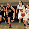 """Mead's Marina Hanion (14) leads a fast break during the game at Mead High School on Friday, Jan. 4, 2013. Mead beat Skyline 52-40. For more photos visit  <a href=""""http://www.BoCoPreps.com"""">http://www.BoCoPreps.com</a>. <br /> (Greg Lindstrom/Times-Call)"""