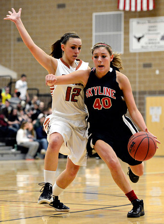 "Skyline's Carissa Curtis (40) tries to drive past Mead's Riglie Reeves (12) during the game at Mead High School on Friday, Jan. 4, 2013. Mead beat Skyline 52-40. For more photos visit  <a href=""http://www.BoCoPreps.com"">http://www.BoCoPreps.com</a>. <br /> (Greg Lindstrom/Times-Call)"