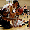 """Skyline's Deandra Elcock, left, and Mead's Kasey McKrola compete for a loose ball during the game at Mead High School on Friday, Jan. 4, 2013. Mead beat Skyline 52-40. For more photos visit  <a href=""""http://www.BoCoPreps.com"""">http://www.BoCoPreps.com</a>. <br /> (Greg Lindstrom/Times-Call)"""