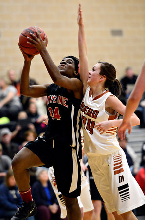 "Skyline's Deandra Elcock, left, goes up for a shot over Mead's Rylee Ward during the game at Mead High School on Friday, Jan. 4, 2013. Mead beat Skyline 52-40. For more photos visit  <a href=""http://www.BoCoPreps.com"">http://www.BoCoPreps.com</a>. <br /> (Greg Lindstrom/Times-Call)"
