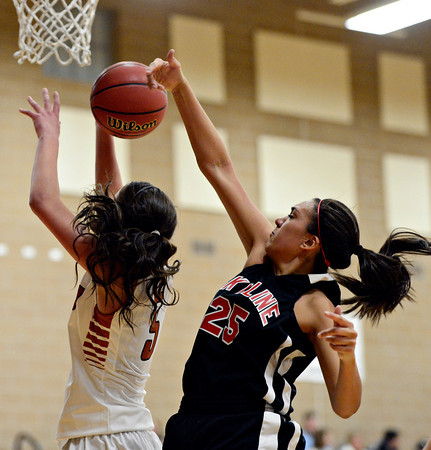 "Skyline's Naomi Barron (25) blocks a shot by Mead's Mikayla Martinez during the game at Mead High School on Friday, Jan. 4, 2013. Mead beat Skyline 52-40. For more photos visit  <a href=""http://www.BoCoPreps.com"">http://www.BoCoPreps.com</a>. <br /> (Greg Lindstrom/Times-Call)"