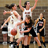 """Skyline's Kaylee Spencer looks to pass around Mead's Mikayla Martinez (5) and Kasey McKrola during the game at Mead High School on Friday, Jan. 4, 2013. Mead beat Skyline 52-40. For more photos visit  <a href=""""http://www.BoCoPreps.com"""">http://www.BoCoPreps.com</a>. <br /> (Greg Lindstrom/Times-Call)"""